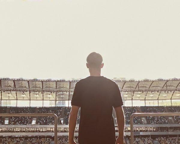 Fan enters stadium 972x376 px_2