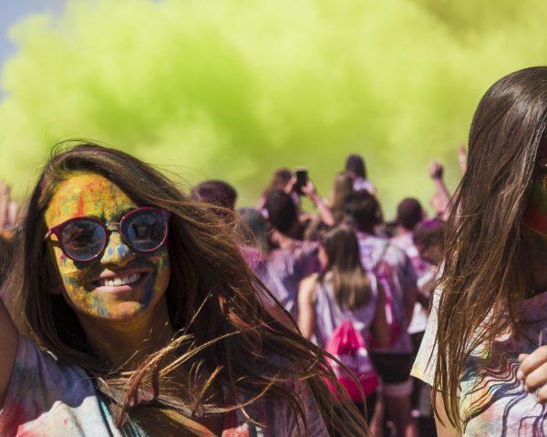 smiling-young-women-dancing-holi-festival